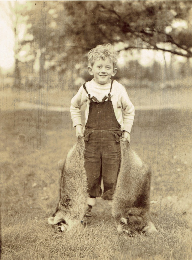 Jimmy Whitbeck with Racoons, 1930s